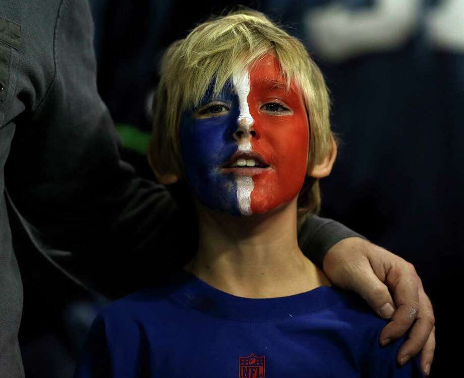A fan looks on during the first half of an NFL football game between the Buffalo Bills and the Seattle Seahawks on Sunday, Dec. 16, 2012, in Toronto. Photo: AP