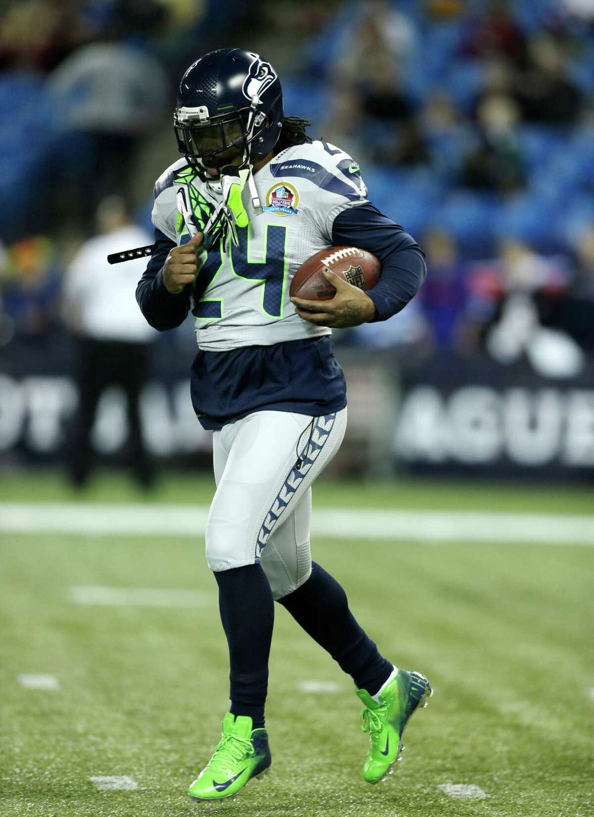 Seattle Seahawks running back Marshawn Lynch (24) warms up before an NFL football game against the Buffalo Bills on Sunday, Dec. 16, 2012, in Toronto.
