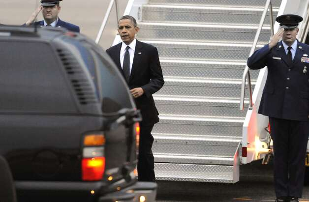 President Obama arrives at the Bradley Air National Guard Base in East Granby, Conn., Sunday, Dec. 16, 2012. The President is in Connecticut to attend a vigil for the victims of the Sandy Hook Elementary School shooting where 26 people, including 20 children, were killed Friday.  Photo: Jessica Hill, Associated Press