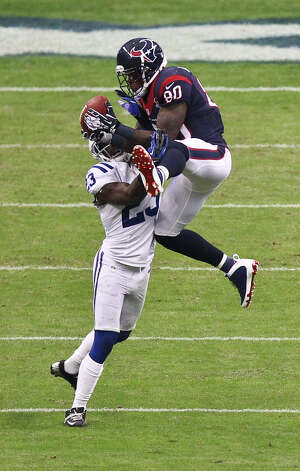 Houston Texans wide receiver Andre Johnson (80) makes a midfield catch over Indianapolis Colts cornerback Vontae Davis (23) during the first quarter of a NFL football game, Sunday, Dec. 16, 2012, in Reliant Stadium in Houston. Photo: Nick De La Torre, Houston Chronicle / © 2012  Houston Chronicle