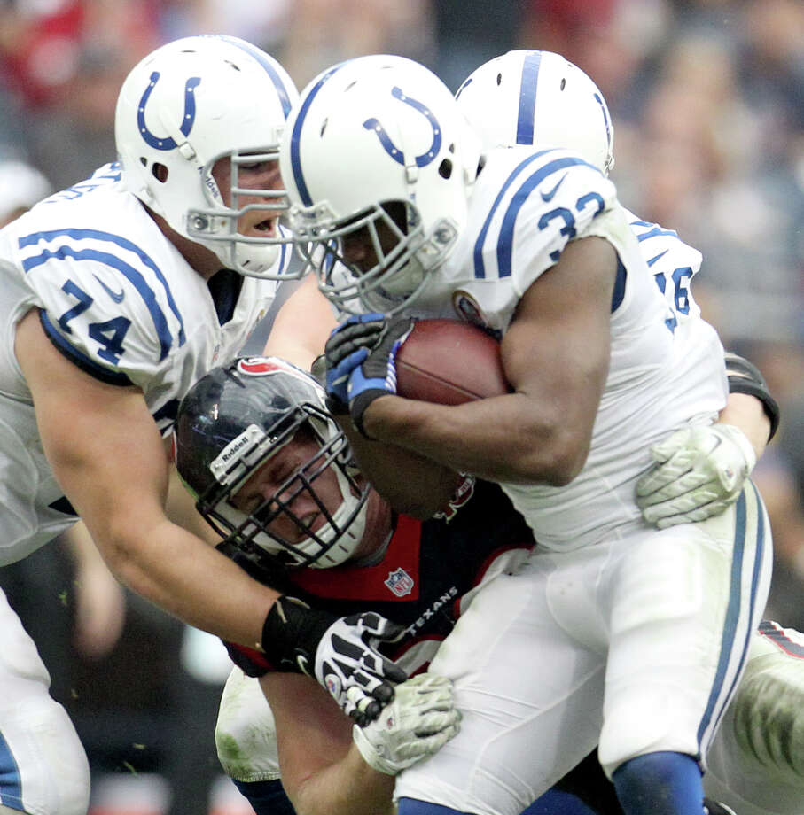 Indianapolis Colts running back Vick Ballard (33) is stopped by Houston Texans defensive end J.J. Watt (99) during the second quarter of an NFL football game at Reliant Stadium, Sunday, Dec. 16, 2012, in Houston. Photo: Karen Warren, Houston Chronicle / © 2012 Houston Chronicle