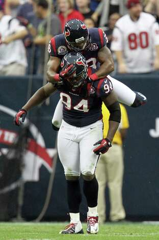 Houston Texans free safety Danieal Manning (38) jumps up on Houston Texans defensive end Antonio Smith (94) after his sack during the first quarter of an NFL football game at Reliant Stadium, Sunday, Dec. 16, 2012, in Houston. Photo: Karen Warren, Houston Chronicle / © 2012 Houston Chronicle