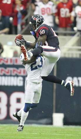 Houston Texans wide receiver Andre Johnson (80) makes a midfield catch as Indianapolis Colts cornerback Vontae Davis (23) tries to defend during the first quarter of an NFL football game at Reliant Stadium, Sunday, Dec. 16, 2012, in Houston. Photo: Karen Warren, Houston Chronicle / © 2012 Houston Chronicle