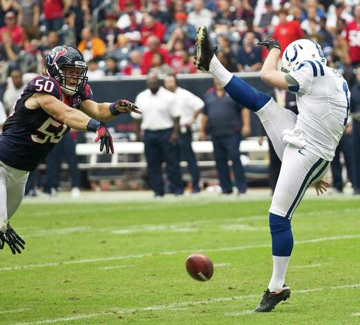 Houston Texans linebacker Bryan Braman (50) blocks Indianapolis Colts punter Pat McAfee (1) punt and scored a touchdown on the live ball during the second quarter at Reliant Stadium on Sunday, Dec. 16, 2012, in Houston. Photo: Brett Coomer, Houston Chronicle / © 2012  Houston Chronicle