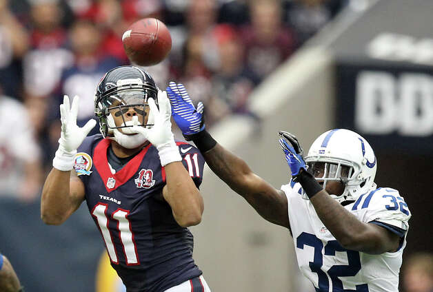 Houston Texans wide receiver DeVier Posey (11) makes a first down catch as Indianapolis Colts cornerback Cassius Vaughn (32) tries to defend during the second quarter of a NFL football game, Sunday, Dec. 16, 2012, in Reliant Stadium in Houston. Photo: Nick De La Torre, Houston Chronicle / © 2012  Houston Chronicle