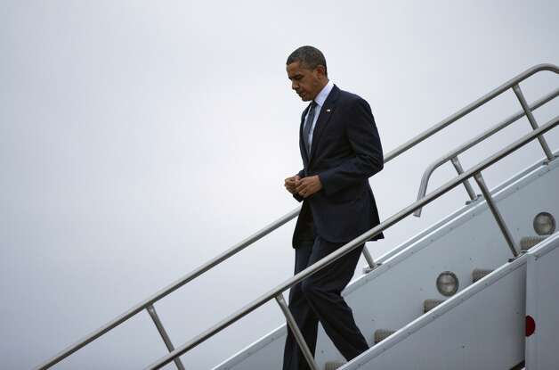 President Barack Obama arrives at Bradley Air National Guard Base on Sunday, Dec. 16, 2012, in East Granby, Conn. He is scheduled to attend an interfaith vigil for the victims of Friday's Sandy Hook Elementary School shooting in Newtown, Conn., where a gunman killed 26 people, including 20 children.  Photo: Evan Vucci, Associated Press