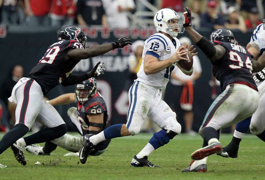 Indianapolis Colts quarterback Andrew Luck (12) is surrounded by Houston Texans defenders as he tries to make a play during the fourth quarter of a NFL football game, Sunday, Dec. 16, 2012, in Reliant Stadium in Houston. Photo: Nick De La Torre, Houston Chronicle / © 2012  Houston Chronicle