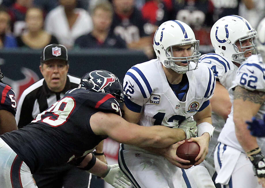 Houston Texans defensive end J.J. Watt (99) is able to get to Indianapolis Colts for a second sack of the fourth quarter during a NFL football game, Sunday, Dec. 16, 2012, in Reliant Stadium in Houston. Photo: Nick De La Torre, Houston Chronicle / © 2012  Houston Chronicle