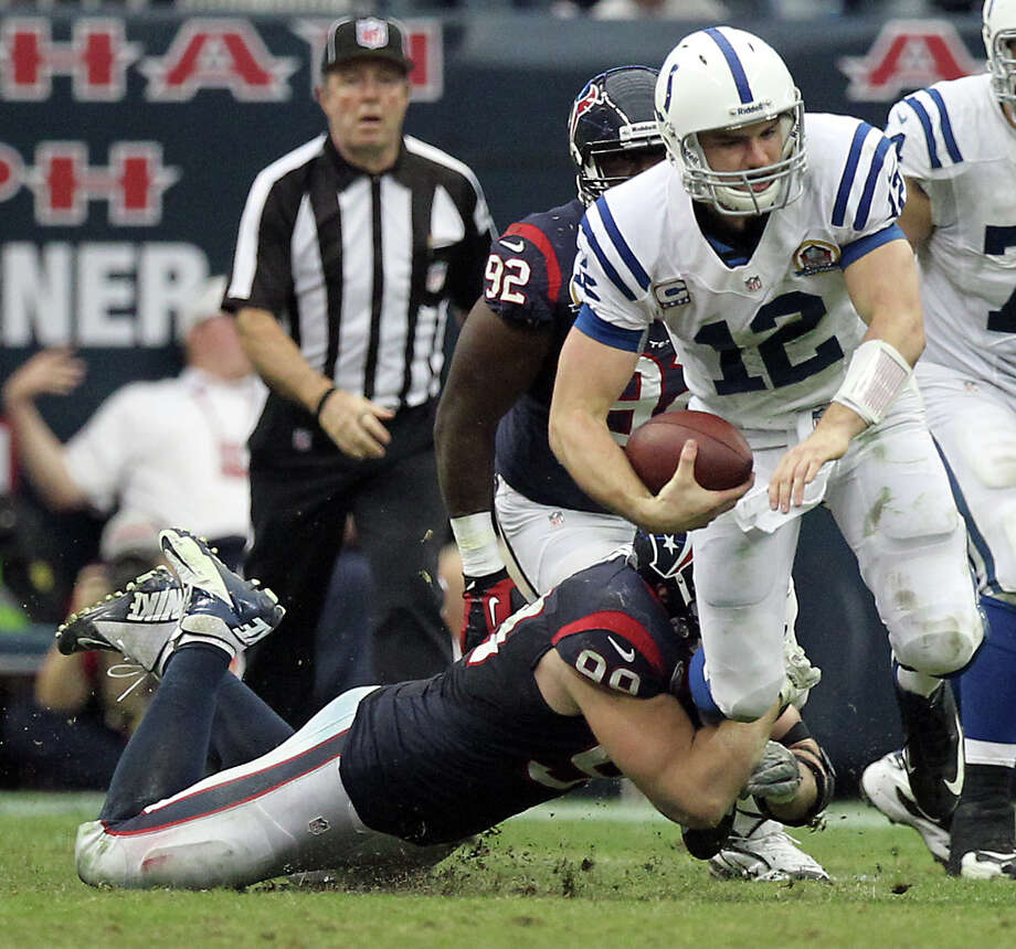 Houston Texans defensive end J.J. Watt (99) brings down Indianapolis Colts quarterback Andrew Luck (12) for a sack during the fourth quarter of a NFL football game, Sunday, Dec. 16, 2012, in Reliant Stadium in Houston. Photo: Nick De La Torre, Houston Chronicle / © 2012  Houston Chronicle