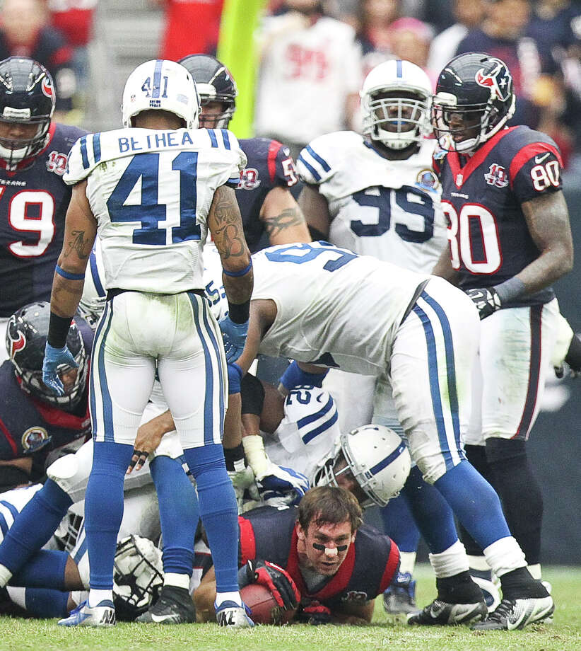 Houston Texans tight end Owen Daniels (81) looses his helmet after fighting for extra yards on a midfield catch during the third quarter of a NFL football game against the Indianapolis Colts, Sunday, Dec. 16, 2012, in Reliant Stadium in Houston. Photo: Nick De La Torre, Houston Chronicle / © 2012  Houston Chronicle
