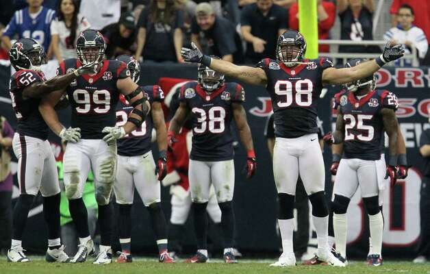 Houston Texans outside linebacker Connor Barwin (98) tries to get the crowd involved during the second quarter of an NFL football game at Reliant Stadium, Sunday, Dec. 16, 2012, in Houston. Photo: Karen Warren, Houston Chronicle / © 2012 Houston Chronicle