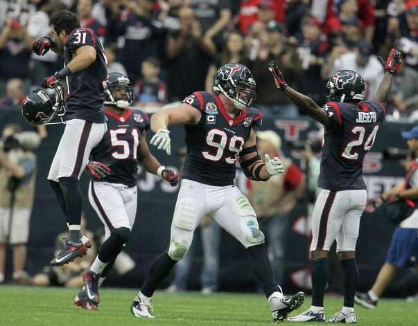 Houston Texans defensive end J.J. Watt (99) and other members of the defense celebrate a turnover during the second quarter of an NFL football game at Reliant Stadium, Sunday, Dec. 16, 2012, in Houston. Photo: Karen Warren, Houston Chronicle / © 2012 Houston Chronicle