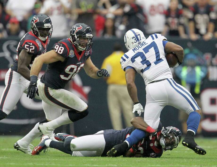 Houston Texans free safety Danieal Manning (38) tries to tackle Colts Mewelde Moore (37) during the second quarter of an NFL football game at Reliant Stadium, Sunday, Dec. 16, 2012, in Houston. Photo: Karen Warren, Houston Chronicle / © 2012 Houston Chronicle