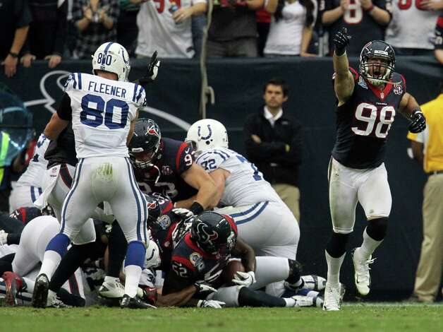 Houston Texans outside linebacker Connor Barwin (98) reacts after inside linebacker Tim Dobbins (52) after his turnover during the second quarter of an NFL football game at Reliant Stadium, Sunday, Dec. 16, 2012, in Houston. Photo: Karen Warren, Houston Chronicle / © 2012 Houston Chronicle