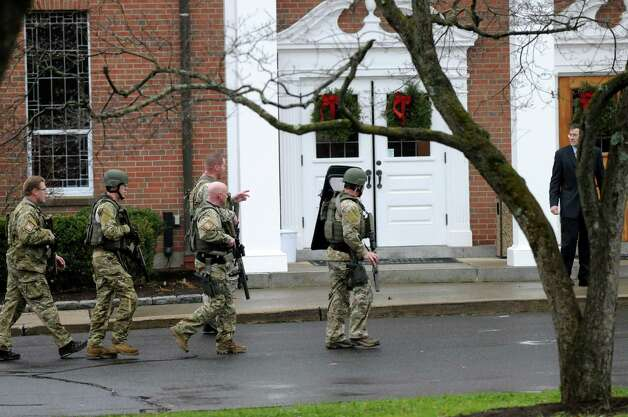 Armed State Police members responded to a threat at Saint Rose of Lima Catholic Church in Newtown, Conn., Sunday Dec. 16, 2012. The church was evacuated in the middle of Sunday services. Photo: Will Waldron, Hearst Newspapers/Will Waldron / The News-Times