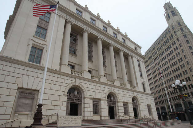 "The Hipolito F. Garcia Federal Building and United States Courthouse has been updated with sustainability features making it one of the ""greenest"" buildings in the downtown area. The building has solar panels on the roof, an electric refueling station for cars, a vegetated ""green"" roof, gray water collection, low flow water fixtures and much more. The building on the right is the Emily Morgan Hotel. Photo: JOHN DAVENPORT, San Antonio Express-News / ©San Antonio Express-News/Photo Can Be Sold to the Public"