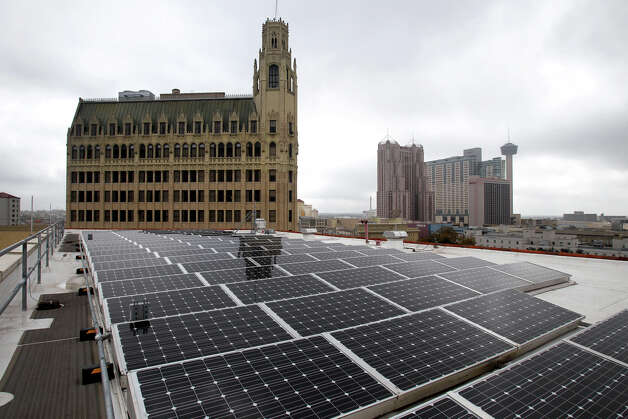 "Solar panels on the roof of the Hipolito F. Garcia Federal Building are one of the many new sustainability features at the building. Other features include an electric refueling station, bike racks, a vegetated ""green"" roof, window improvements and more. Photo: JOHN DAVENPORT, San Antonio Express-News / ©San Antonio Express-News/Photo Can Be Sold to the Public"