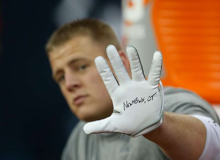 HOUSTON, TX - DECEMBER 16:  J.J. Watt #99 of the Houston Texans displays a glove to remember the victims of the massacre at Sandy Hook Elementary School in Newtown, Connecticut prior to the start of the game against the Indianapolis Colts at at Reliant Stadium on December 16, 2012 in Houston, Texas.  (Photo by Scott Halleran/Getty Images) *** BESTPIX *** Photo: Scott Halleran, Getty Images