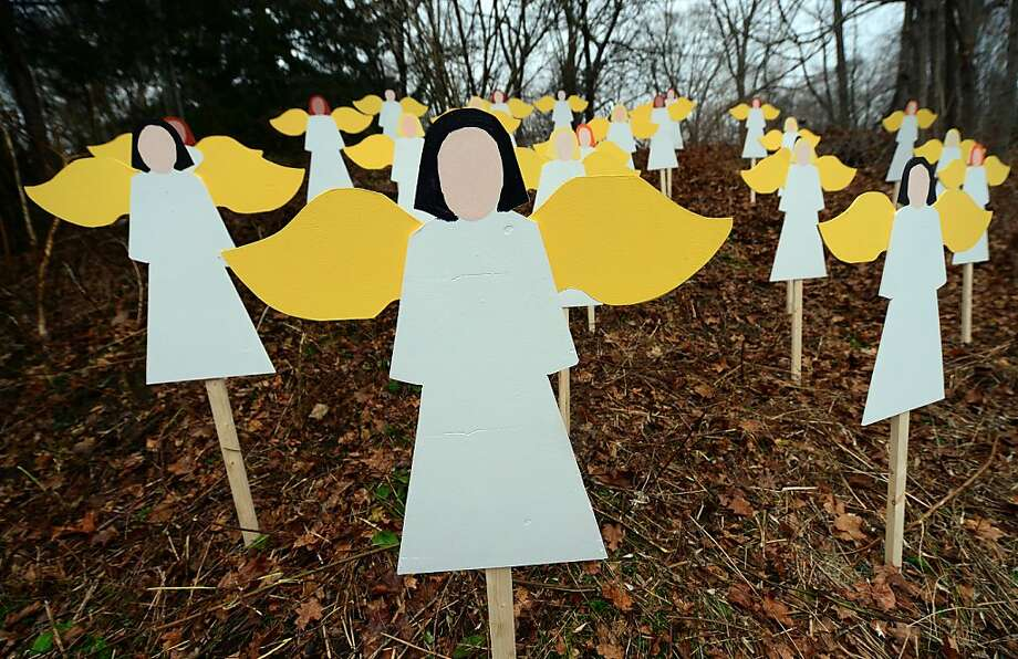 Twenty seven angel wood cut-outs are set up on hillside in memory to the victims of an elementary school shooting in Newtown, Connecticut, December 16, 2012. Photo: Emmanuel Dunand, AFP/Getty Images