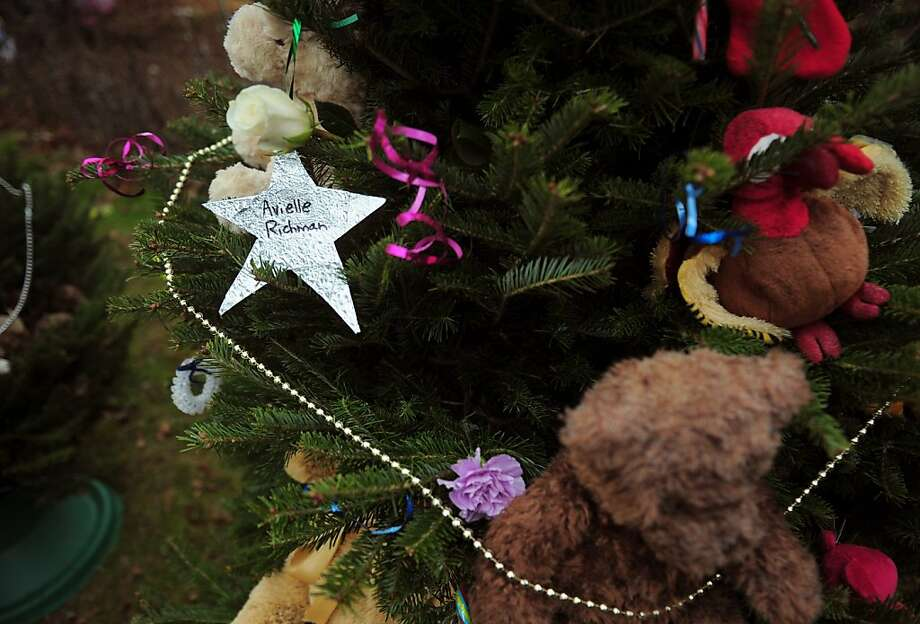 A star bearing the name of one of an elementary school shooting adorns a christmas tree set up at a makeshift shrine to the victims of a elementary school shooting in Newtown, Connecticut, December 16, 2012.  A young gunman slaughtered 20 small children and six teachers on December 14,2012 after walking into a school in an idyllic Connecticut town wielding at least two sophisticated firearms. AFP PHOTO/Emmanuel DUNANDEMMANUEL DUNAND/AFP/Getty Images Photo: Emmanuel Dunand, AFP/Getty Images