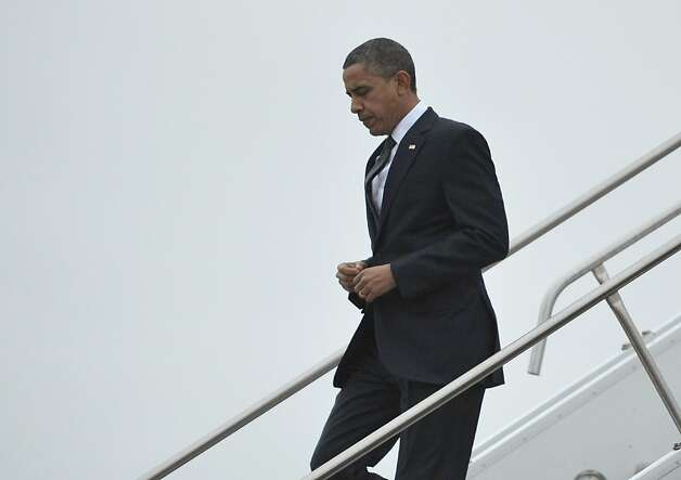 US President Barack Obama steps off Air Force One upon arrival at Bradley Air National Guard Base in East Granby, Connecticut, on December 16, 2012. Obama is heading to Newtown, Connecticut, to attend a memorial service for victims of the Sandy Hook Elementary School shooting. AFP PHOTO/Mandel NGANMANDEL NGAN/AFP/Getty Images Photo: Mandel Ngan, AFP/Getty Images