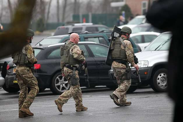 State police check buildings on the St. Rose of Lima Church campus in the Sandy Hook section of Newtown, Conn. after an unspecified threat on Sunday, Dec. 16, 2012. Parishioners were evacuated during noon mass. Photo: BK Angeletti, B.K. Angeletti