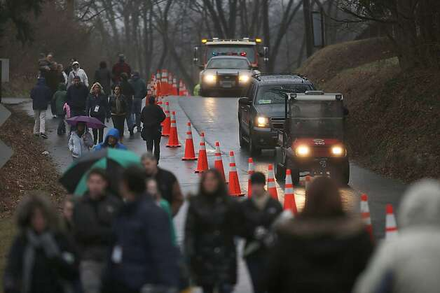 NEWTOWN, CT - DECEMBER 16:  Thousands of people make their way to a memorial in front of the Sandy Hook School December 16, 2012 in Newtown, Connecticut. Twenty-six people were shot dead, including twenty children, after a gunman identified as Adam Lanza opened fire at Sandy Hook Elementary School. Lanza also reportedly had committed suicide at the scene. A 28th person, believed to be Nancy Lanza, found dead in a house in town, was also believed to have been shot by Adam Lanza.  (Photo by Spencer Platt/Getty Images) Photo: Spencer Platt, Getty Images
