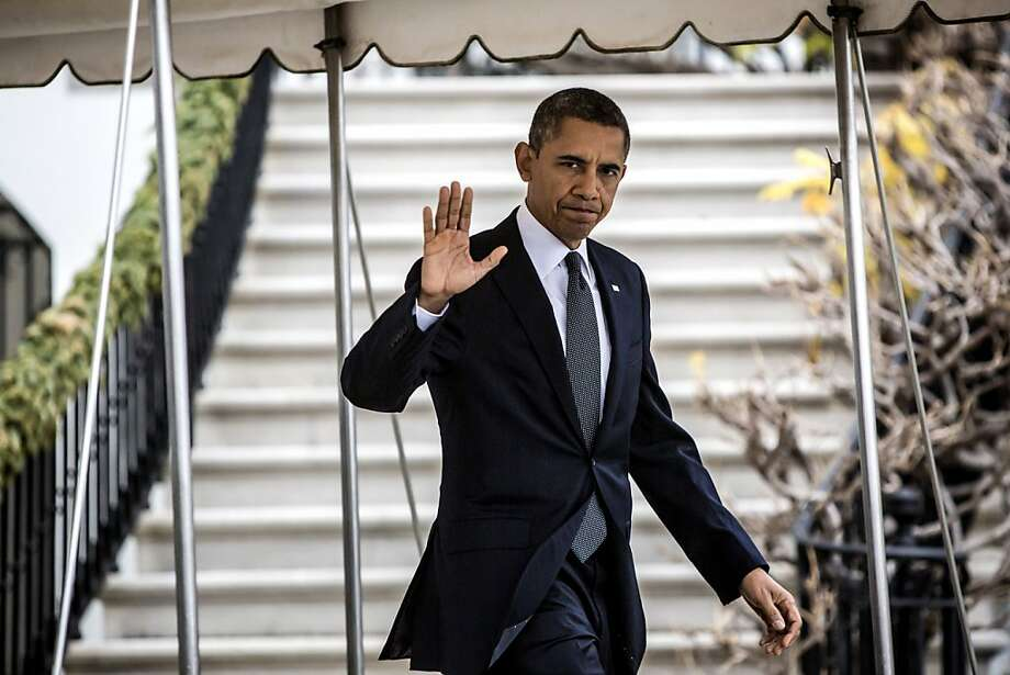 WASHINGTON, DC - DECEMBER 16:  (AFP OUT)  U.S. President Barack Obama waves as he departs the White House to travel to Connecticut December 16, 2012 in Washington, DC. President Obama will meet with the families of victims of the shooting at Sandy Hook Elementary School in Newtown.  (Photo by Brendan Hoffman-Pool/Getty Images) Photo: Pool, Getty Images