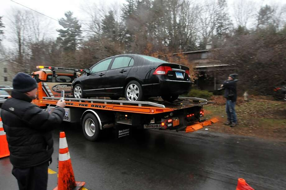 A black Honda Civic is transported from the Sandy Hook Elementary School crime scene, Sunday Dec. 16, 2012, in Newtown Conn. The car appears to match a description of the vehicle Adam Lanza drove to the school on the day of the tragic shooting on Dec. 14, 2012. Photo: Will Waldron, Hearst Newspapers/Will Waldron