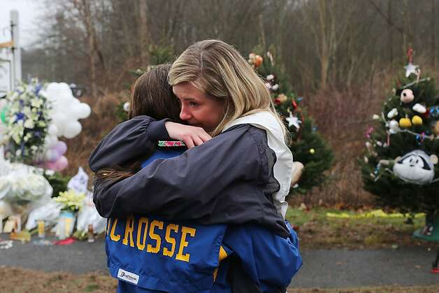 Kristen Brassard (Left) and Kat Donohue, both of Newtown, hug outside of the Sandy Hook School December 16, 2012 in Newtown, Connecticut.  Photo: Spencer Platt, Getty Images