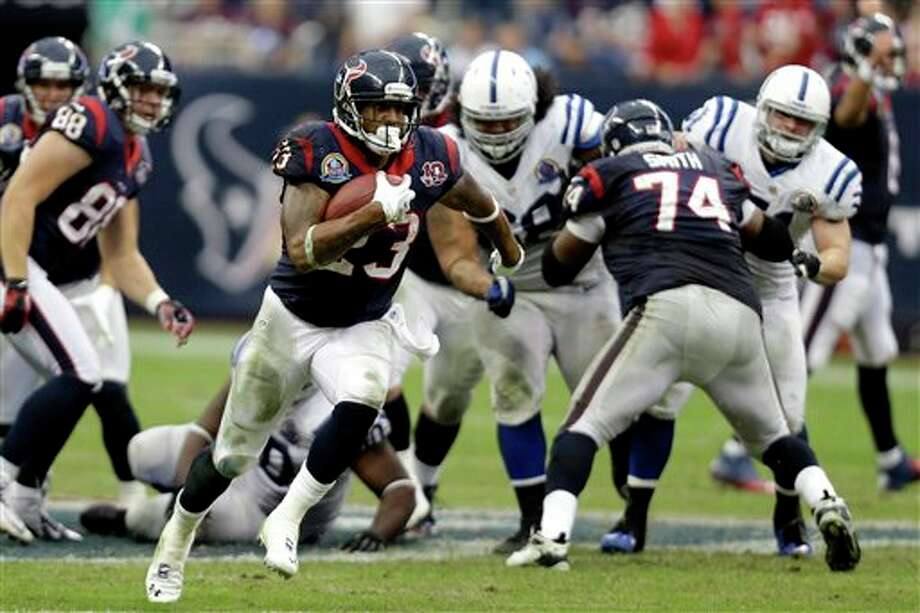 Houston Texans running back Arian Foster (23) rushes for a gain against the Indianapolis Colts in the fourth quarter of an NFL football game on Sunday, Dec. 16, 2012, in Houston. The Texans defeated the Colts 29-17. (AP Photo/Eric Gay) Photo: Eric Gay, Associated Press / AP