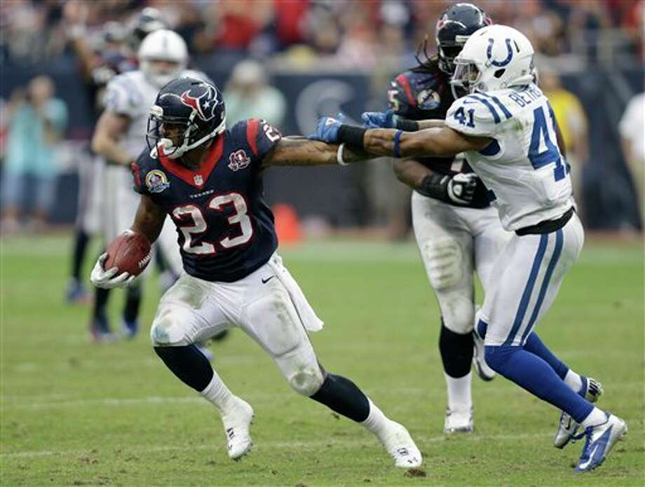 Houston Texans' Arian Foster (23) runs past Indianapolis Colts' Antoine Bethea (41) in the fourth quarter of an NFL football game Sunday, Dec. 16, 2012, in Houston. (AP Photo/Eric Gay) Photo: Eric Gay, Associated Press / AP