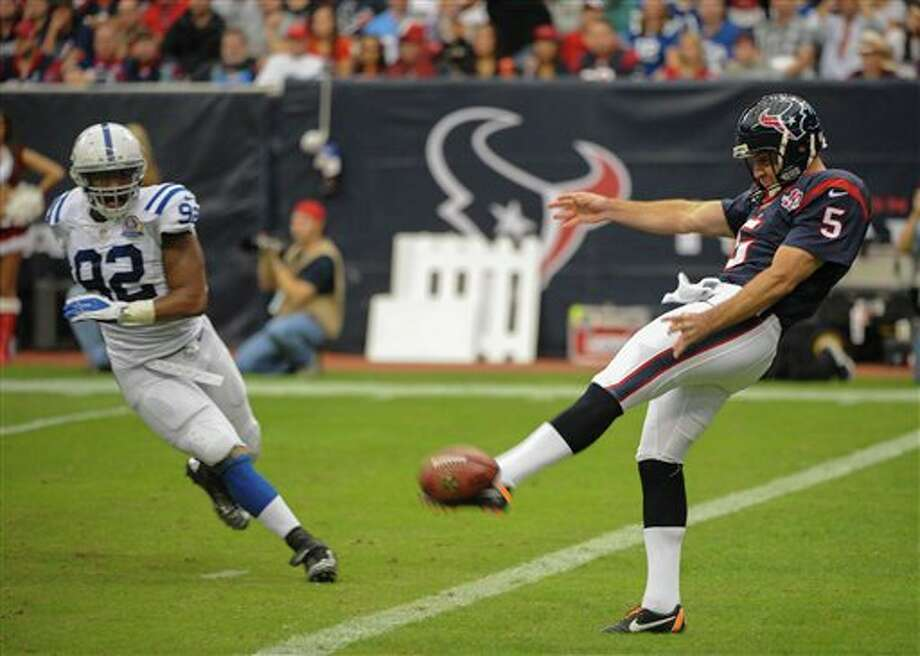 Houston Texans punter Donnie Jones (5) miss kicks a punt as Indianapolis Colts' Jerry Hughes (92) defends in the second quarter of an NFL football game Sunday, Dec. 16, 2012, in Houston. (AP Photo/Dave Einsel) Photo: Dave Einsel, Associated Press / FR43584 AP