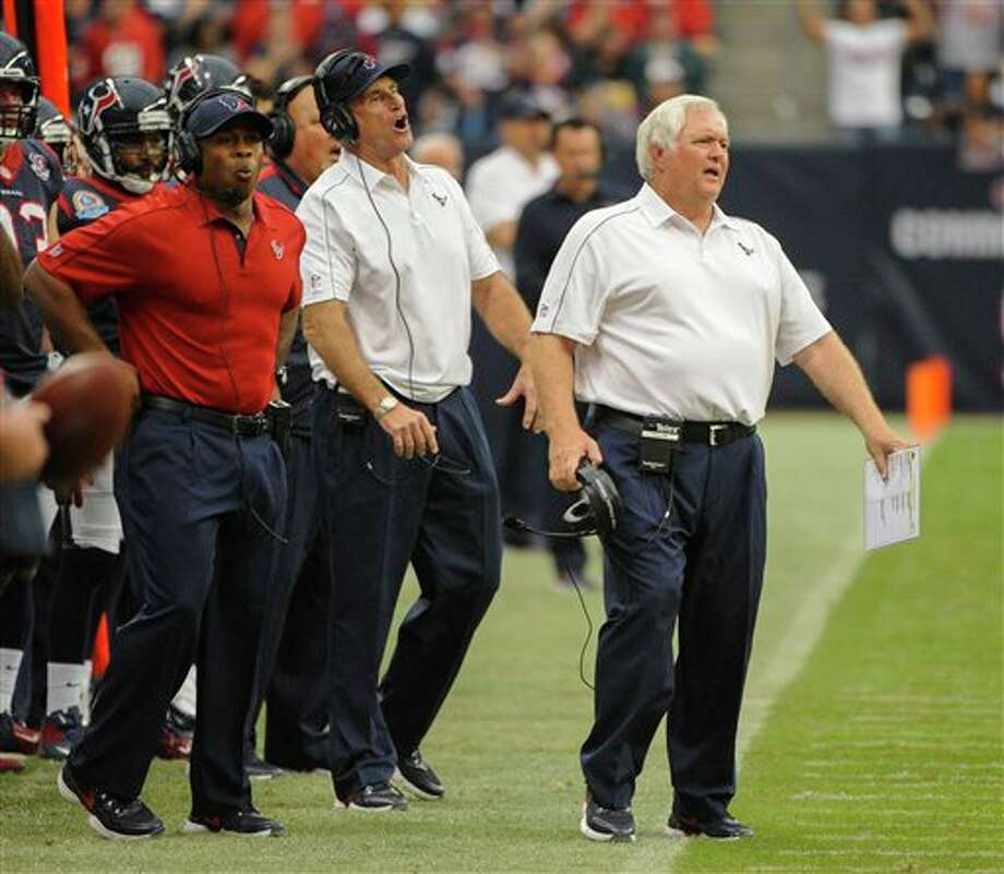Houston Texans defensive coordinator Wade Phillips, right, reacts to a penalty in the second quarter of an NFL football game against the Indianapolis Colts, Sunday, Dec. 16, 2012, in Houston. (AP Photo/Dave Einsel) Photo: Dave Einsel, Associated Press / FR43584 AP