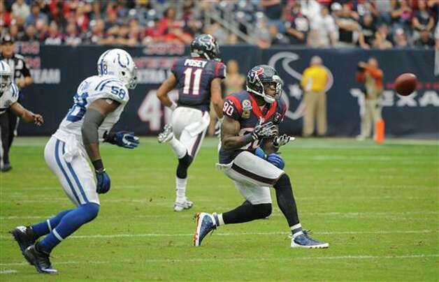 Houston Texans' Andre Johnson (80) prepares to make a catch in front of Indianapolis Colts' Moise Fokou (58) in the second quarter of an NFL football game Sunday, Dec. 16, 2012, in Houston. (AP Photo/Dave Einsel) Photo: Dave Einsel, Associated Press / FR43584 AP