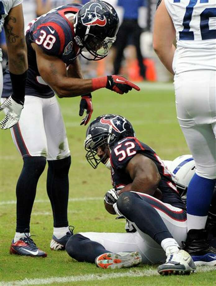Houston Texans inside linebacker Tim Dobbins (52) recovers a fumble by Indianapolis Colts Mewelde Moore at the goal line as Texans' Danieal Manning (38) gestures in the second quarter of an NFL football game on Sunday, Dec. 16, 2012, in Houston. (AP Photo/Dave Einsel) Photo: Dave Einsel, Associated Press / FR43584 AP
