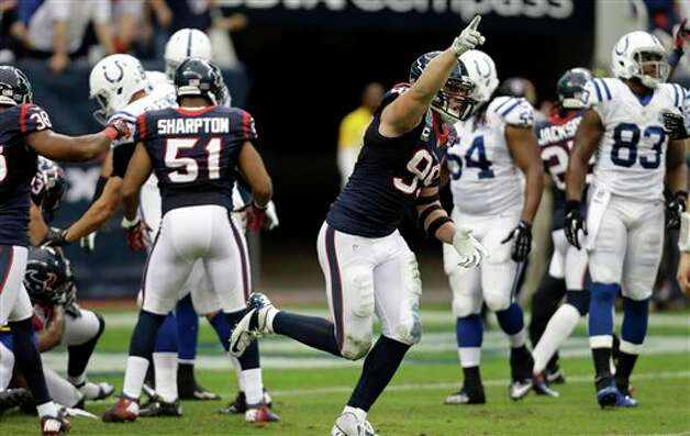 Houston Texans defensive end J.J. Watt (99) celebrates after the Texans recovered an Indianapolis Colts fumble in the second quarter of an NFL football game Sunday, Dec. 16, 2012, in Houston. (AP Photo/Eric Gay) Photo: Eric Gay, Associated Press / AP