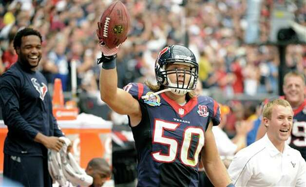 Houston Texans linebacker Bryan Braman (50) celebrates on the bench after blocking a punt and returning it for a touchdown in the second quarter of an NFL football game against the Indianapolis Colts, Sunday, Dec. 16, 2012, in Houston. (AP Photo/Dave Einsel) Photo: Dave Einsel, Associated Press / FR43584 AP