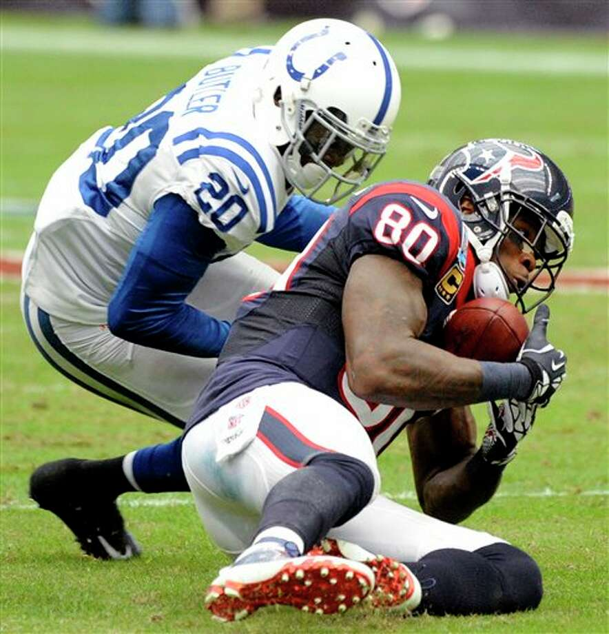 Houston Texans wide receiver Andre Johnson (80) catches a pass as Indianapolis Colts cornerback Darius Butler (20) defends in the second quarter of an NFL football game on Sunday, Dec. 16, 2012, in Houston. (AP Photo/Dave Einsel) Photo: Dave Einsel, Associated Press / FR43584 AP