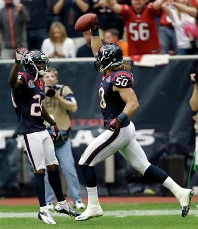 Houston Texans linebacker Bryan Braman (50) celebrates with Johnathan Joseph, left, after blocking a punt and returning it for a touchdown in the second quarter of an NFL football game  against the Indianapolis Colts, Sunday, Dec. 16, 2012, in Houston. (AP Photo/Eric Gay) Photo: Eric Gay, Associated Press / AP