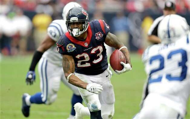 Houston Texans running back Arian Foster (23) rushes for a gain as Indianapolis Colts cornerback Vontae Davis, right, defends in the third quarter of an NFL football game on Sunday, Dec. 16, 2012, in Houston. (AP Photo/Eric Gay) Photo: Eric Gay, Associated Press / AP