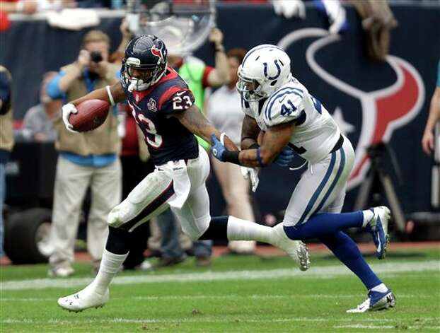 Houston Texans running back Arian Foster (23) is tackled by Indianapolis Colts free safety Antoine Bethea (41) in the third quarter of an NFL football game on Sunday, Dec. 16, 2012, in Houston. (AP Photo/Eric Gay) Photo: Eric Gay, Associated Press / AP
