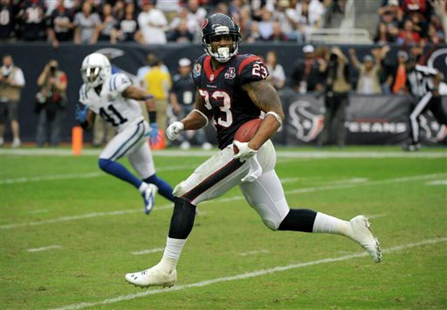 Houston Texans running back Arian Foster (23) rushes for a touchdown as Indianapolis Colts free safety Antoine Bethea (41) pursues in the fourth quarter of an NFL football game on Sunday, Dec. 16, 2012, in Houston. (AP Photo/Dave Einsel) Photo: Dave Einsel, Associated Press / FR43584 AP