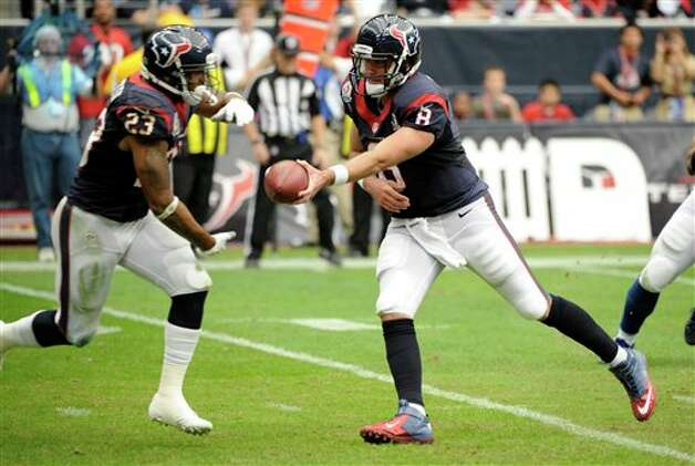 Houston Texans quarterback Matt Schaub (8) hands off to running back Arian Foster (23) in the third quarter of an NFL football game against the Indianapolis Colts Sunday, Dec. 16, 2012, in Houston. (AP Photo/Dave Einsel) Photo: Dave Einsel, Associated Press / FR43584 AP