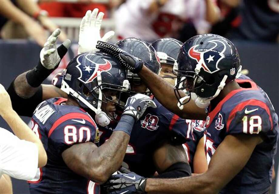 Houston Texans wide receiver Andre Johnson (80) is congratulated by teammates, including Lestar Jean (18), after catching touchdown pass in the first quarter of an NFL football game against the Indianapolis Colts, Sunday, Dec. 16, 2012, in Houston. (AP Photo/Eric Gay) Photo: Eric Gay, Associated Press / AP2012