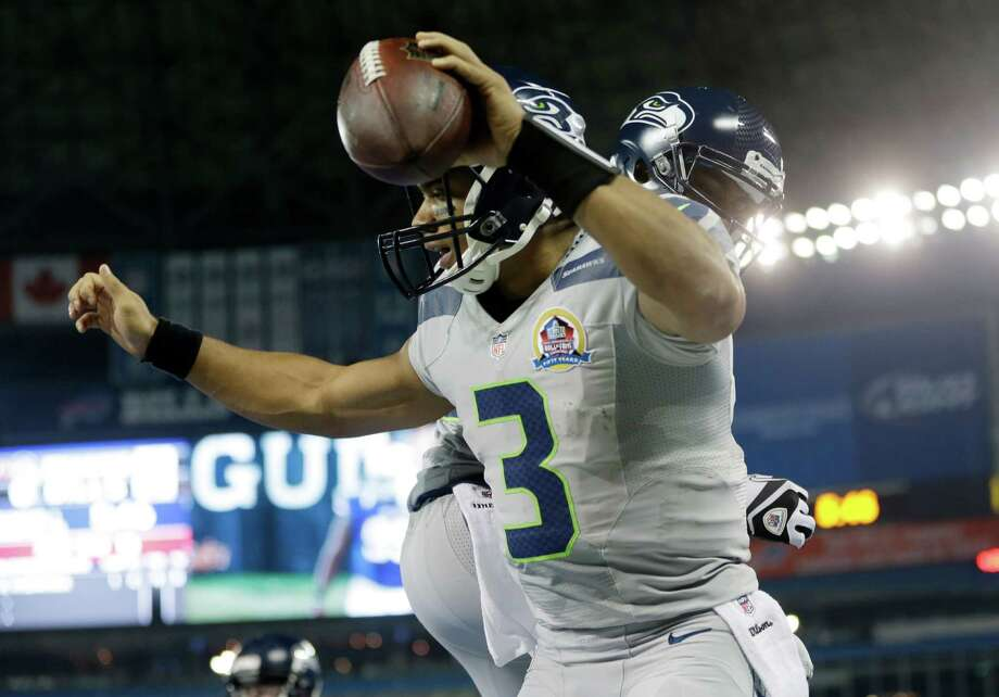 Seattle Seahawks quarterback Russell Wilson (3) reacts after scoring a touchdown against the Buffalo Bills during the first half of an NFL football game on Sunday, Dec. 16, 2012, in Toronto. Photo: AP