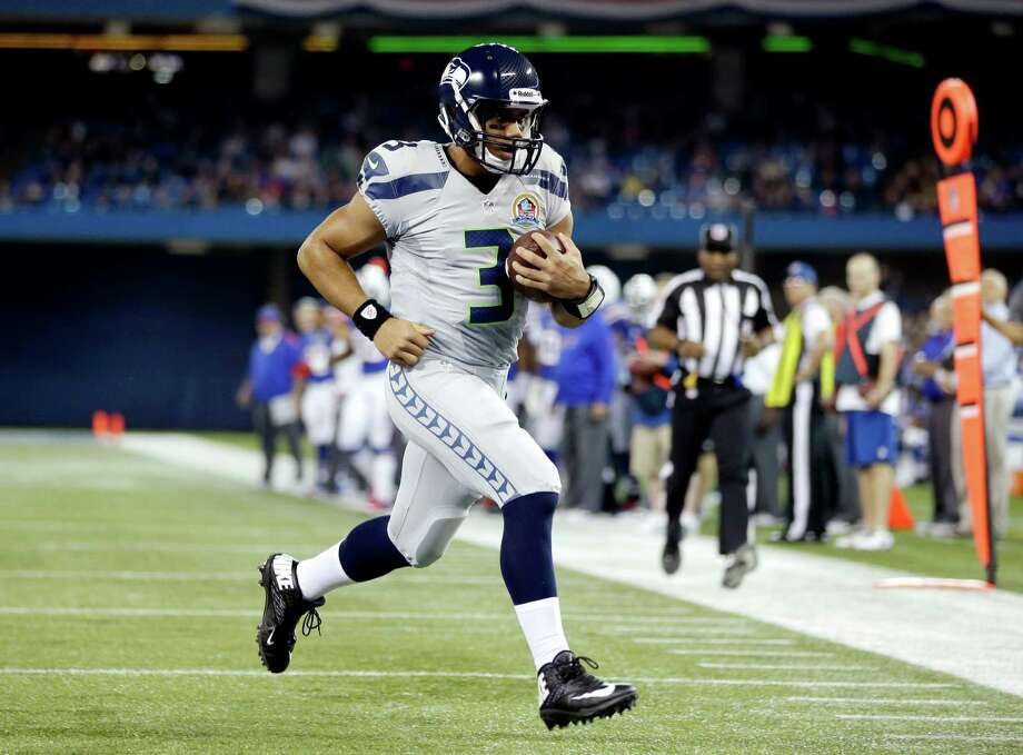 Seattle Seahawks quarterback Russell Wilson (3) runs for a touchdown against the Buffalo Bills during the first half of an NFL football game, Sunday, Dec. 16, 2012, in Toronto. Photo: AP