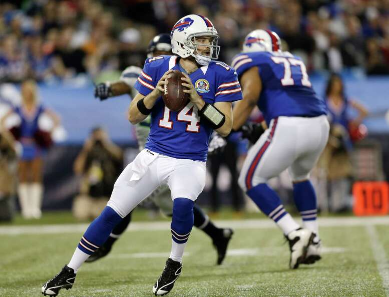 Buffalo Bills quarterback Ryan Fitzpatrick (14) passes against the Seattle Seahawks during the first