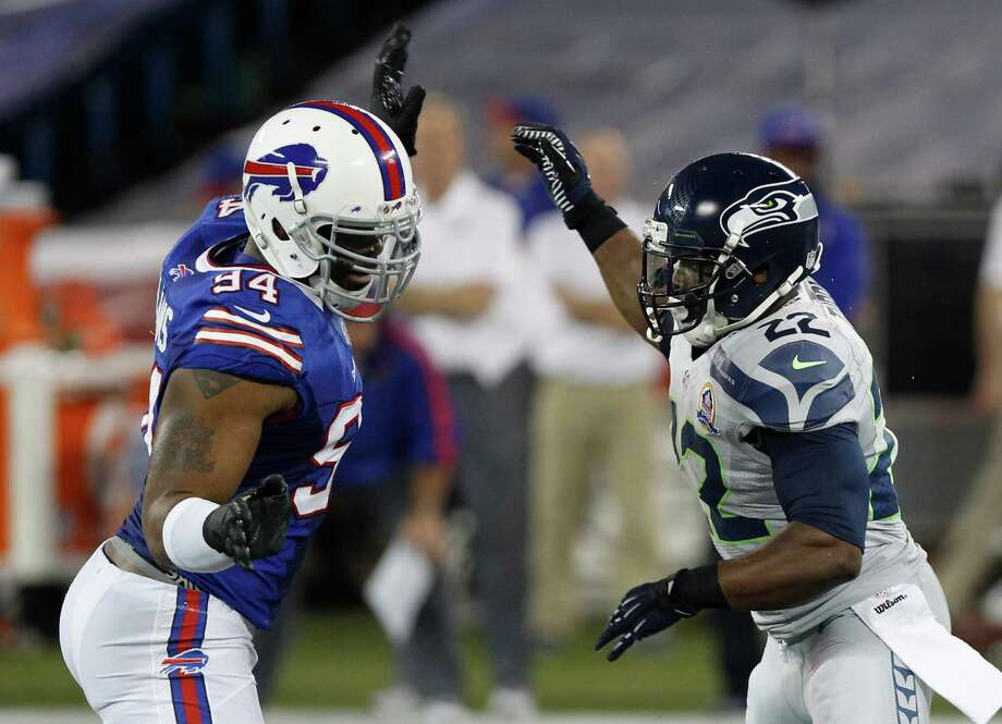 Buffalo Bills defensive end Mario Williams (94) works against Seattle Seahawks running back Robert Turbin (22) during the first half of an NFL football game on Saturday, Dec. 15, 2012, in Toronto. Photo: AP