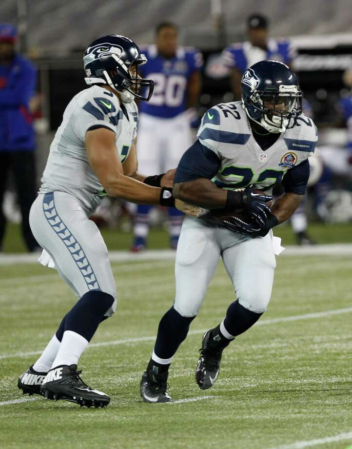 Seattle Seahawks quarterback Russell Wilson (3) hands off to Seattle Seahawks running back Robert Turbin (22) during the first half of an NFL football game on Saturday, Dec. 15, 2012, in Toronto. Photo: AP
